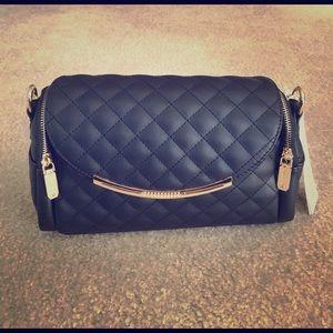 Brand new black shoulder purse.