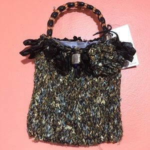 Handmade beaded handle knitted purse