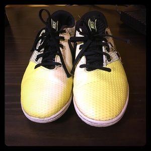 Boys (unisex) Nike soccer style sneakers.
