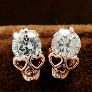 Jewelry - New rose gold tone crystal skull earrings