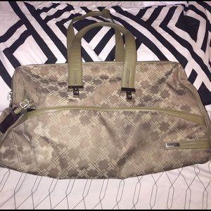 Tumi Handbags - Authentic Tumi Travel Satchel.