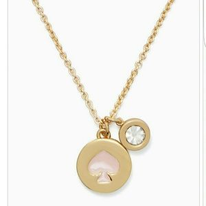 kate spade Jewelry - Nwt kate spade necklace. Pink spade charm.