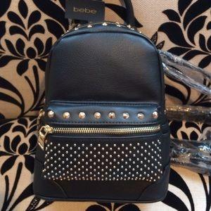 bebe Handbags - ✨NEW✨BEBE Gold Studded Black Mini Leather Backpack