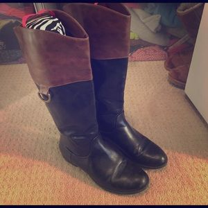 Brown and black tall leather boots