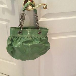 Ladies patent leather DKNY handbag w/chain detail