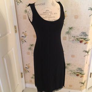 Versus By Versace Dresses & Skirts - VERSUS black dress with high slit and fringe hem.