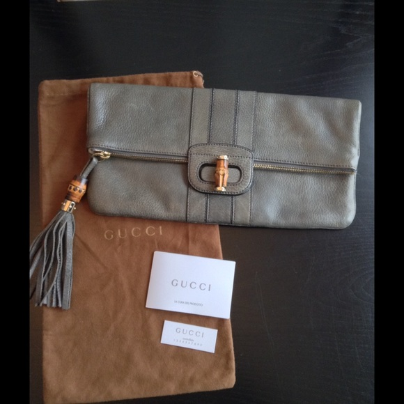 1b0a72091f8 Gucci Handbags - Gucci  Lucy  Bamboo Tassel Gray Leather Clutch