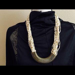 Cream colored multi strand beaded necklace