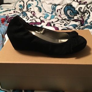Black suede wedges with a bow