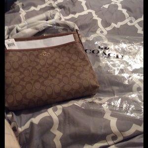 Coach Handbags - Brand New Khaki/Saddle Crossbody Coach purse.