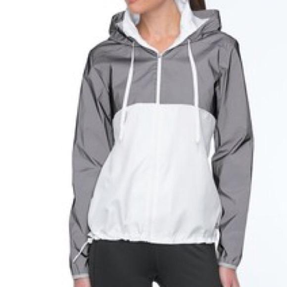 726f7a52c1b9 FILA Jackets   Blazers - FILA SPORT® Reflective Hooded Windbreaker Jacket