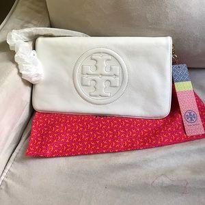 Tory Burch Handbags - NWT magenta leather bombe reva clutch