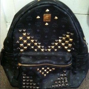 MCM Handbags - I'm selling my mcm back pack it's brand new