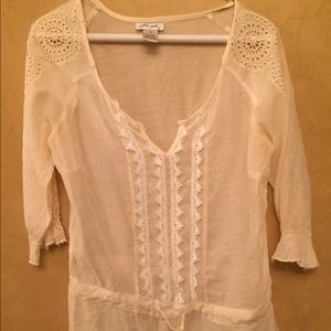 Sheer cream top. Lace on sleeves