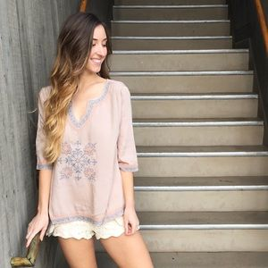tan embroidered top