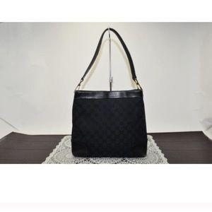 Gucci Handbags - Authentic black monogrammed Gucci shoulder bag