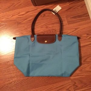 Longchamp Handbags - NWT Longchamp baby blue cornflower