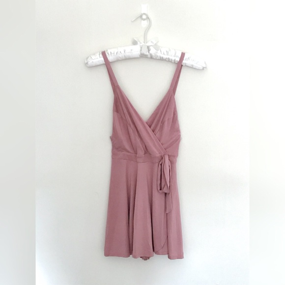 6ca9da26e1f3 Kimchi Blue Veruca Skorted Wrap Romper. M 58b5b8d9bcd4a7ef3e00b3e0. Other  Dresses you may like. Urban Outfitters Reformed feather dress