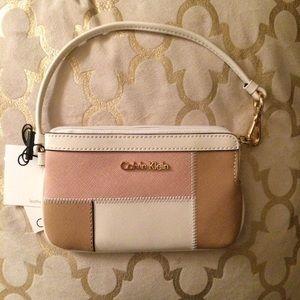 Calvin Klein Handbags - NWT Calvin Klein leather wristlet patchwork