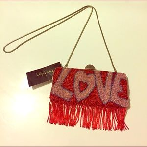 "Nicole Miller Handbags - NWT Nicole Miller beaded ""Love"" bag"