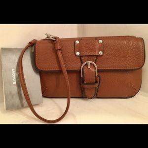 Lacoste Handbags - NWT Lacoste wristlet; pouch; ladies purse; handbag