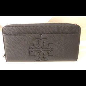 Tory Burch Handbags - Brand new Tory Burch zip around wallet. Unused!