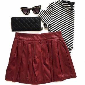 a'gaci Dresses & Skirts - Burgundy Faux Leather Pleated Mini Skirt