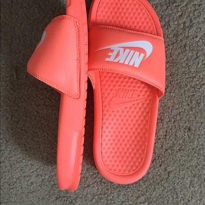 510a5700cbef5e Nike Shoes - Nike orange coral mango slides white Nike logo