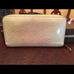 Sold Authentic Louis Vuitton large wallet