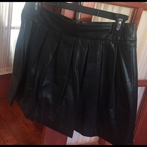 Adorable pleated black leather faux skirt