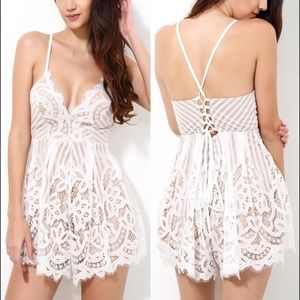 Delicate white lace and nude eyelash romper