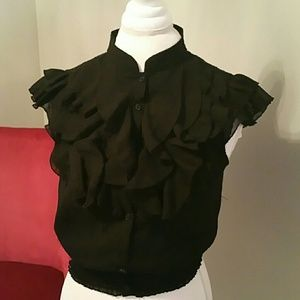 Ruffled blouse with sheer back.
