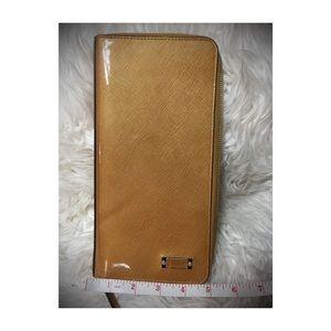 Tumi Handbags - 💛 Tumi Zip Around Travel Organizer in Gold