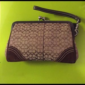 Brown Coach Wristlet with perfect closure.