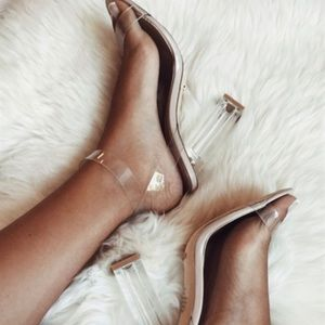 BRAND NEW WITH TAGS AND BOX CLEAR HEELS