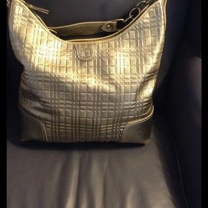 Burberry Mettalic gold hobo bag.S 05 2