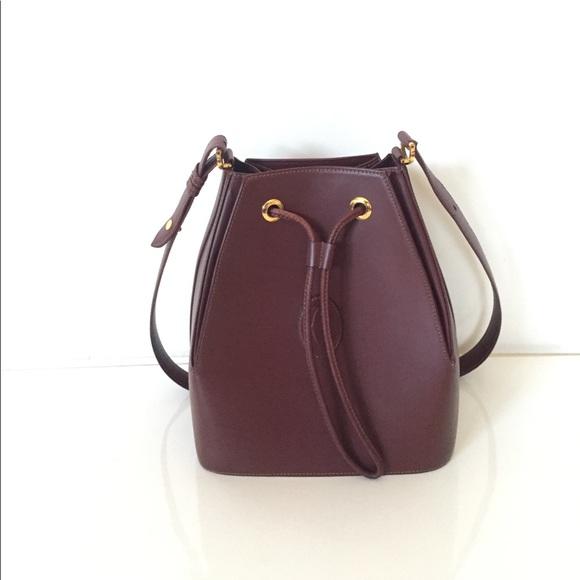 89ecaa2a4e Cartier Handbags - Les Must De Cartier Burgundy Bucket Bag