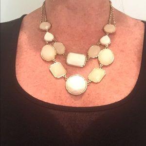Tone on tone cream statement necklace.