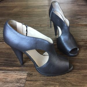 PRADA Metallic leather peep toe pumps