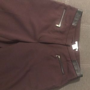 H&M burgundy trousers with leather detail at top.