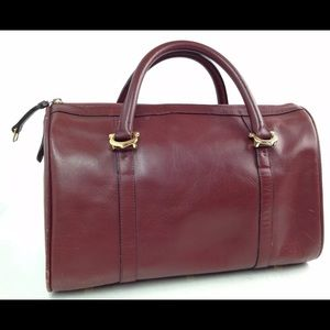 Cartier Handbags - Authentic Cartier Burgundy Leather Purse Classy!