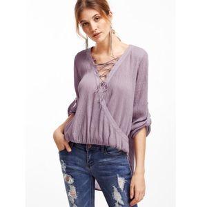 Haute Ellie Tops - Lilac Summer Textured Lace Up Drop Hem Top