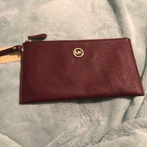 Michael Kors Handbags - Michael Kors Leather large zip clutch wristlet NWT
