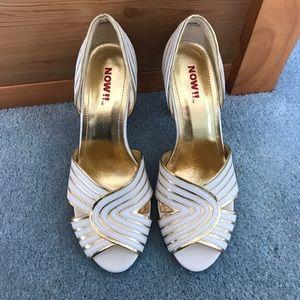 White and gold peep toe heels