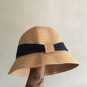 Straw hat with black ribbon