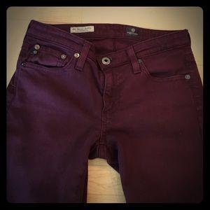 AG eggplant colored slim straight leg jeans