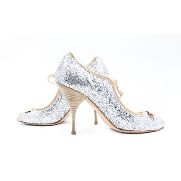 b52aeec38c6 Miu Miu Prada Silver Glitter Maryjane Pumps. M 58bb04b66a583002ad00e1e9