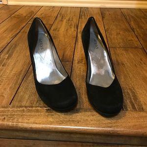 Black guess heels.