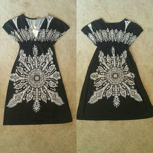 Christina Love  Dresses & Skirts - Lovely Black & White Printed Dress NWT
