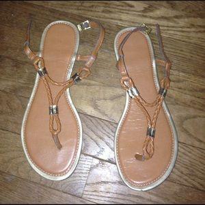 Tan sandals.